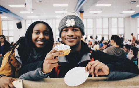 Juniors Kyah Walker and Jaylen Wright enjoy a donut at the honor roll breakfast.
