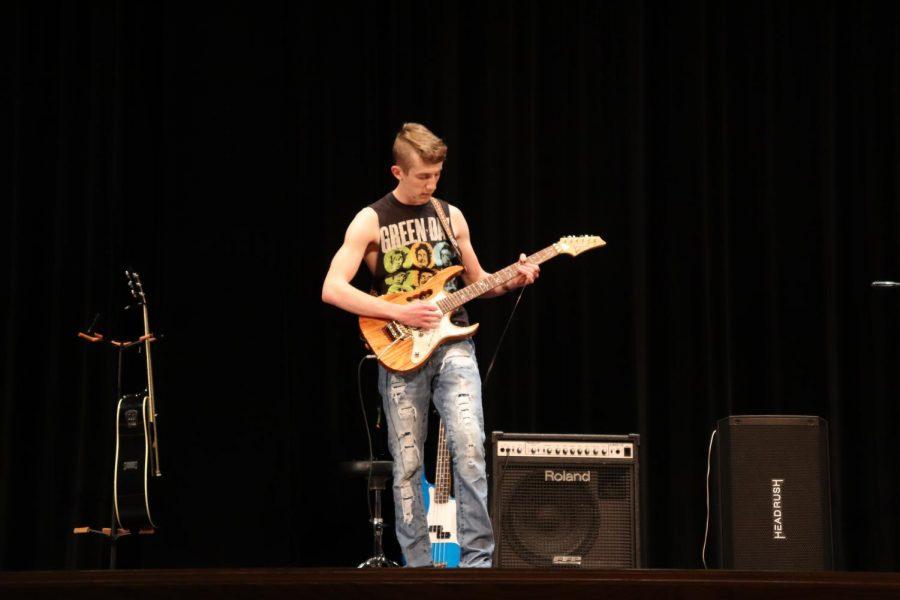 Ryan Downey breaks one guitar string.