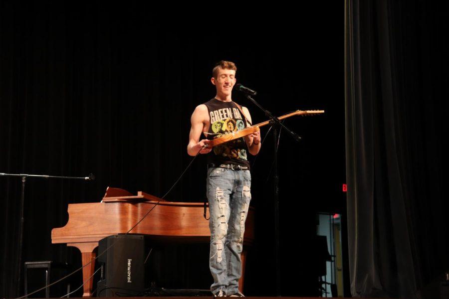 Ryan Downey breaks two guitar strings.
