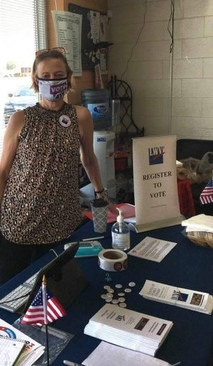 Judy Bradford registering people to vote and giving out voting information.